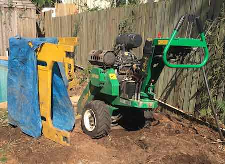 Red Roo SPH400 stump grinding beside pool in Brisbane